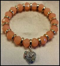 AUTHENTIC JUICY COUTURE ORANGE BEAD PAVE FLOWER HEART CHARM STRETCH BRACELET NWT