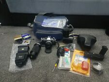 Olympus OM10 35mm SLR Film Camera bundle . 3 lenses and a lot of accessories
