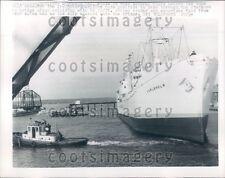 1960 Tug Boats Maneuver Freighter Ship SS Carlshom Wisconsin Press Photo