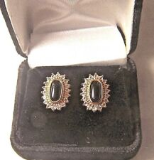 Surrounded By Lots Of Tiny Crystals Set Of Gold-Plated Oval Black Onyx Earrings