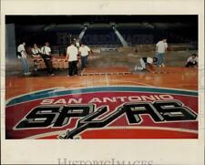 1993 Press Photo Alamodome workers install San Antonio Spurs basketball floor