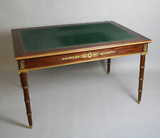 A FRENCH EMPIRE WRITING TABLE WITH ORIGINAL ORMOLU MOUNTS