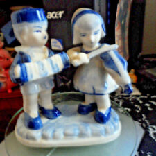 PAIR OF BOY & GIRL DUTCH FIGURES. MUSICIANS. SOME AGE VERY GOOD 13 CM TALL.