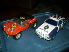 TWO VINTAGE TAIYO TOY CARS(BUGGY AND POLICE CAR)