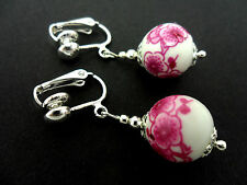 A PAIR OF SIMPLE WHITE/PINK PORCELAIN FLOWER BEAD DROP CLIP ON  EARRINGS. NEW.