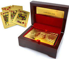 24 K GOLD PLATED PLAYING CARDS IN ELEGANT WOODEN BOX.
