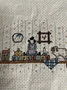 completed cross stitch amish toys quilt on shelf vintage hand made