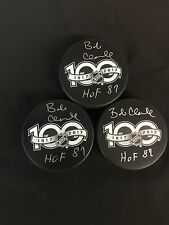 PHILADELPHIA FLYERS BOBBY CLARKE AUTOGRAPHED NHL 100TH ANNIVERSARY PUCK W/COA