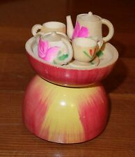 Vintage miniature wooden tea set in apple