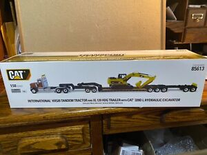 1/50  DIECAST MASTERS CAT INTERNATIONAL & HDG TRAILER WITH CAT 320