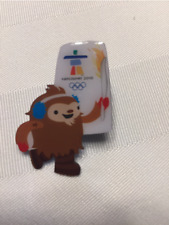 2010 Olympic Pins package - Quatchi carrying Olympic Torch - 95 pins in package