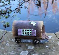 Solar garden decor Small fairy house pixie Log on Wheels outdoor ornament home