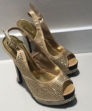 GOLD AND SILVER PLATFORM HEELS WITH GOLD STUDS THROUGHOUT  SZ 6