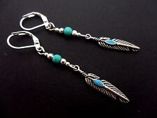 A PAIR TIBETAN SILVER DANGLY  FEATHER/TURQUOISE BEAD LEVERBACK HOOK EARRINGS.