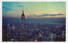 empire state building at night , new york city