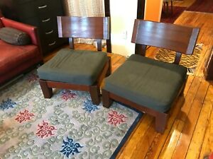 Two mahogany chairs from Indonesia