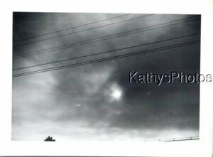 FOUND B&W PHOTO K_6580 VIEW OF SUN BEHIND SMOKE IN THE SKY