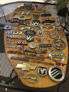 Lot of 57  Pontiac, Cadillac, Chevy, Ford, Saturn, Toyota, VW, Emblems OEM.