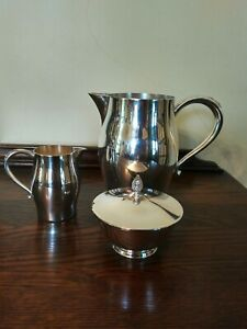 WM A Rogers Silverplate Water Pitcher, Creamer and Covered Sugar Bowl
