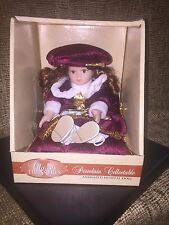 Classic Treasures Animated & Musical Porcelain Doll-burgundy attire
