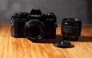 minolta x300swith 50mm f 1.7 lens and 2x teleconverter