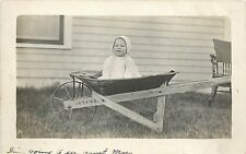 RPPC Postcard Baby in a Vulcan Wheel Barrow