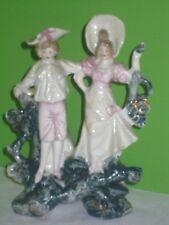 Ancien couple de sujet en porcelaine soliflore