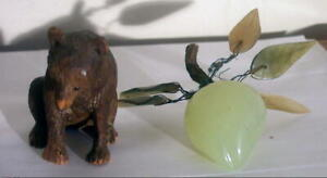 CHINESE PEAR JADE CARVING AND BLACK FOREST BEAR GERMAN CARVING