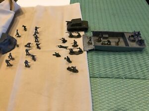 GIANT LANDING CRAFT COMPLETE WITH CREW ,MACHINE GUNS.GIANT SOLDIERS AND TANK.