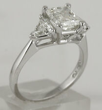 4.02 ct H VS2 radiant trillion cut diamond three stone engagement ring platinum