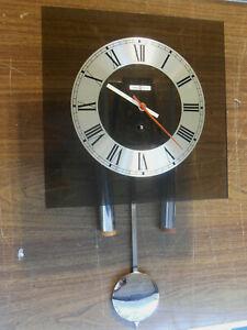 MID-CENTURY HOWARD MILLER ( GEORGE NELSON?) DSGN.  LUCITE/CHROME PENDULUM CLOCK