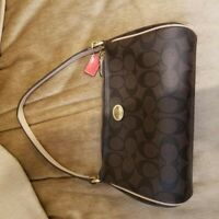Coach small Tan and brown with brown hand purse In Signature Canvas