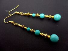 A PAIR OF LONG DANGLY  TURQUOISE & GOLD COLOUR EARRINGS. NEW.