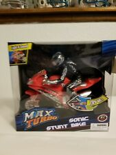 Max Turbo Sonic Stunt Bike Red #28 Plays Music And Lights on. New in box.