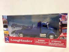 "Peterbilt Model 335, 8"" Towing Truck, 1:43 Diecast, New Ray Toys, Blue"