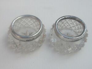 Pair of silver rimmed cut glass salts , London 1871 . Maker WHS