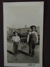 YOUNG BOYS IN OVERALLS WITH FISHING POLE & LINE OF FISH BETWEEN THEM 1928 PHOTO