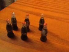 Six miniature Coke Bottles