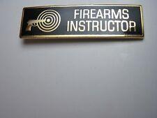 FIREARMS INSTRUCTOR UNIFORM PIN GOLD WITH BLACK ENAMEL POLICE SHERIFF TROOPER*