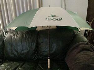 "Sea World Umbrella 54"" arc  Wood handle Green/Tan  Hard to Put UP,  Rust spots"