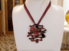 Brand new large enamal pendant on a multi strand ribbon chain in a gift bag