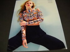 IGGY AZALEA wearing bejeweled style top with blue pants 2014 PROMO DISPLAY PAGE