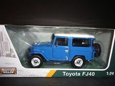 Motormax Toyota FJ40 Blue with White Top 79323 1/24 Platinum Edition