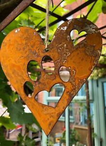 'Paw prints on my heart'. Rustic metal rusty hanging heart. UK made