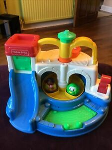 VINTAGE FISHER PRICE TOY GARAGE- WORKING UPPER & LOWER CAROUSELS, RAMP FOR CARS+