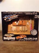 ERTL AMERICAN MUSCLE BODY SHOP SMOKEY AND THE BANDIT SHERIFF CAR 1:64 SCALE