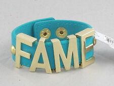 BCBG BCBGeneration Goldtone Turquoise Faux Suede FAME Large Affirmation Bracelet