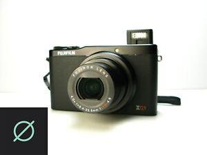 Fujifilm XQ1 12mp Digital Camera X-trans II 25-100mm *Sample Photo*