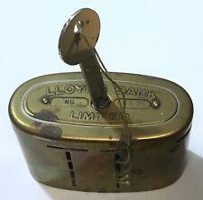 Lloyds Bank brass money box 1930s (?), + £1 blue, 10s, 9x2/6, 8x1/-, 13x6d, 9x3d