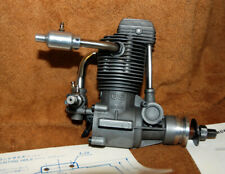 O.S. four stroke FS-61 engine with muffler and parts